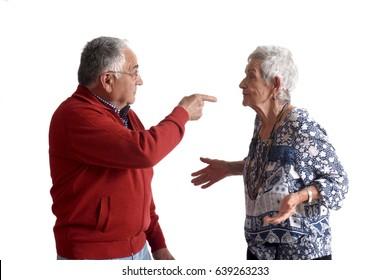 A senior couple arguing on white background