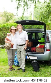 Senior couple arrive at holiday destination