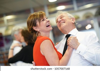 Senior couple attending dance class