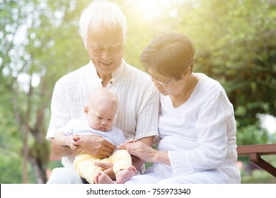 Senior couple with baby grandson, Asian grandparents with grandchild, life insurance concept.
