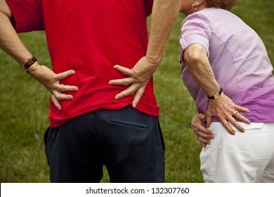 Senior couple with back and hip pain
