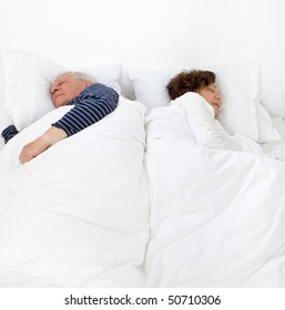 senior couple in bed asleep