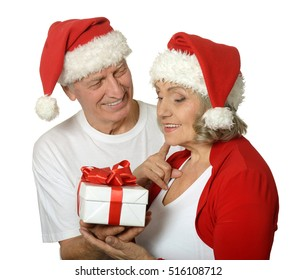 Senior couple with Christmas present