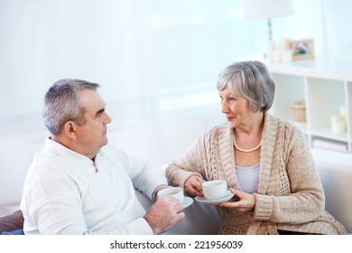 Senior couple communicating at cup of tea