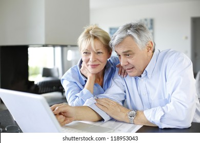 Senior couple connected with family on internet