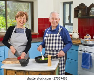 senior couple cooking at their kitchen at home