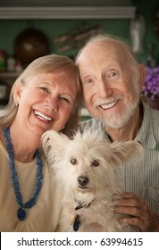 Senior couple with cute white dog