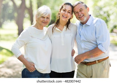 Senior Couple with Daughter in the Park