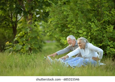 senior couple doing exercises