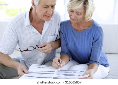 Senior couple doing home finances
