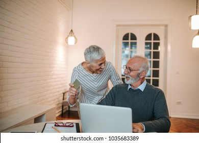 Senior couple doing some online shopping