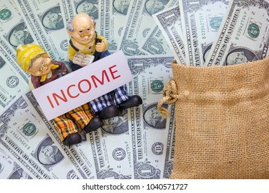 Senior couple doll with word income and Savings Dollar banknote money in sack. Asset investment, Retirement plan, Pension fund, 401K, Wage,Millionaire, Financial freedom, Wealth, Capital gain concept.
