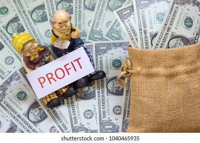 Senior couple dolls with word Profit on sack and Savings Dollar banknote money. Growth asset investment, Retirement plan, Pension fund and 401K, Millionaire, Financial freedom,wealth, Benefit concept.