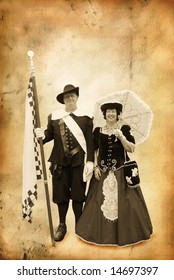 Senior couple dressed in historic clothes from the 17th century on grunge background