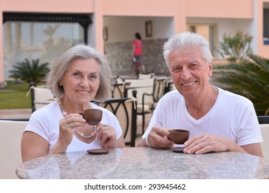 Senior couple drinking coffee at the resort during vacation