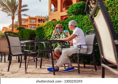 Senior couple drinking tea in hotel cafe. People enjoying vacation. Valentine's day