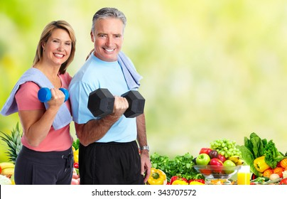 Senior couple with dumbbell. Healthy lifestyle background.