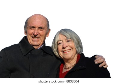 Senior couple embracing and smiling isolated on a white background.