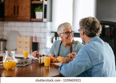 Senior couple enjoying breakfast together at home