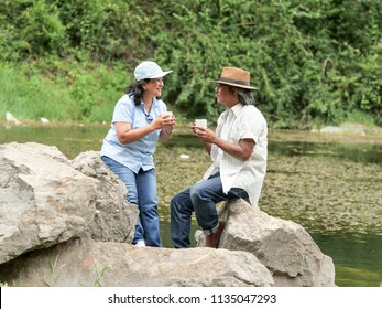Senior Couple Enjoying Camping trip,They are drink coffee in the morning together.