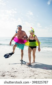 Senior couple enjoying on beach on a sunny day