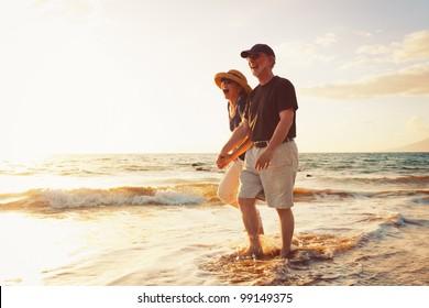 Senior Couple Enjoying Sunset at the Beach