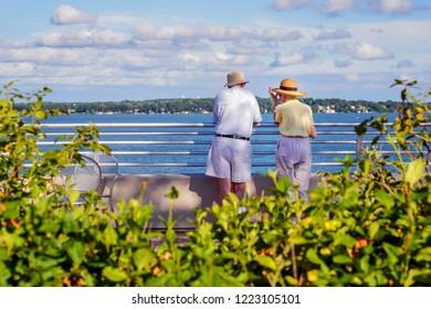Senior couple enjoying time together by a lake