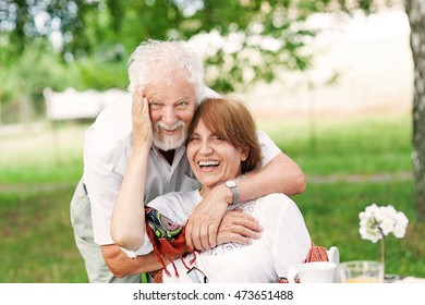 Senior couple exchanging tenderness, shallow depth of field
