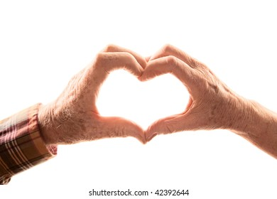 Senior couple forming heart by touching hands together