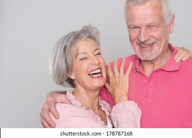 Senior couple  in front of grey background