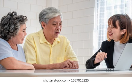 Senior couple get advice from financial planner at home.aging at home