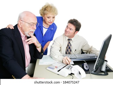 Senior couple getting financial advice from their accountant.  White background.