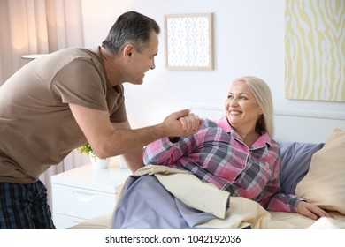 Senior couple getting up in morning together