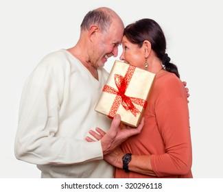 senior couple with gift happy