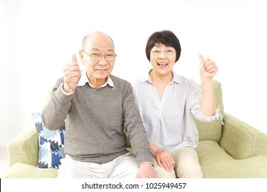 Senior couple giving good sign