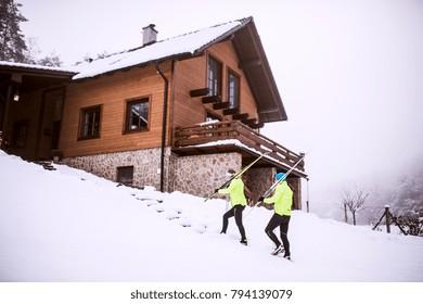 Senior couple going cross-country skiing.