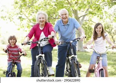 Senior couple with grandchildren on bikes