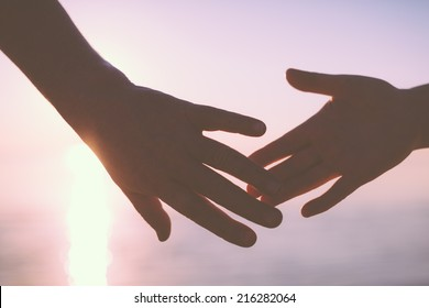Senior couple hands reach silhouette