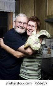 Senior couple having fun in the kitchen