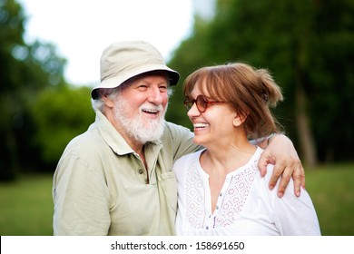 Senior couple having good time outdoors, shallow depth of field