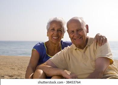 Senior couple having a good time at the beach