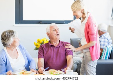 Senior couple having lunch together in a retirement home