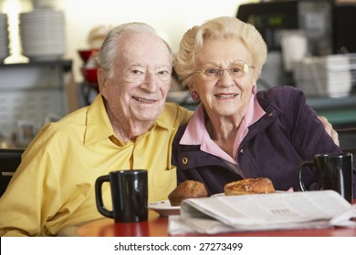 Senior couple having morning tea together