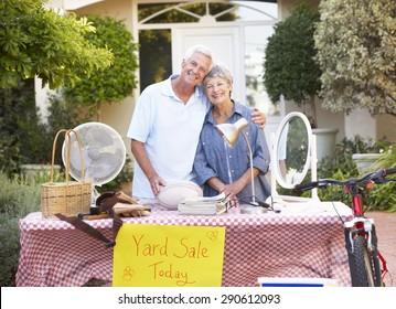 Senior Couple Holding Yard Sale