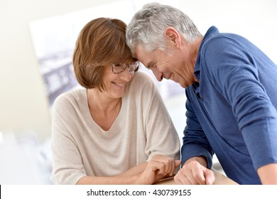 Senior couple at home having fun together