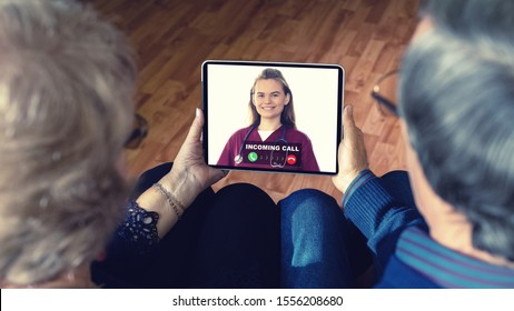 Senior couple at home holding digital tablet during video call with family doctor – virtual care remote consultation with elderly telehealth patients and medic specialist in telemedicine conversation