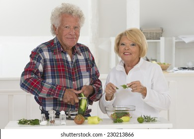 senior couple at home preparing meal together