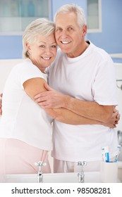 Senior couple hugging in bathroom