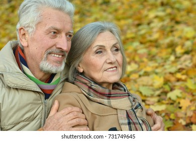 senior couple hugging   in the park