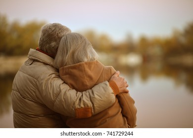 senior couple hugging in park